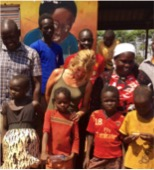 Maureen with refugees in Uganda, Africa