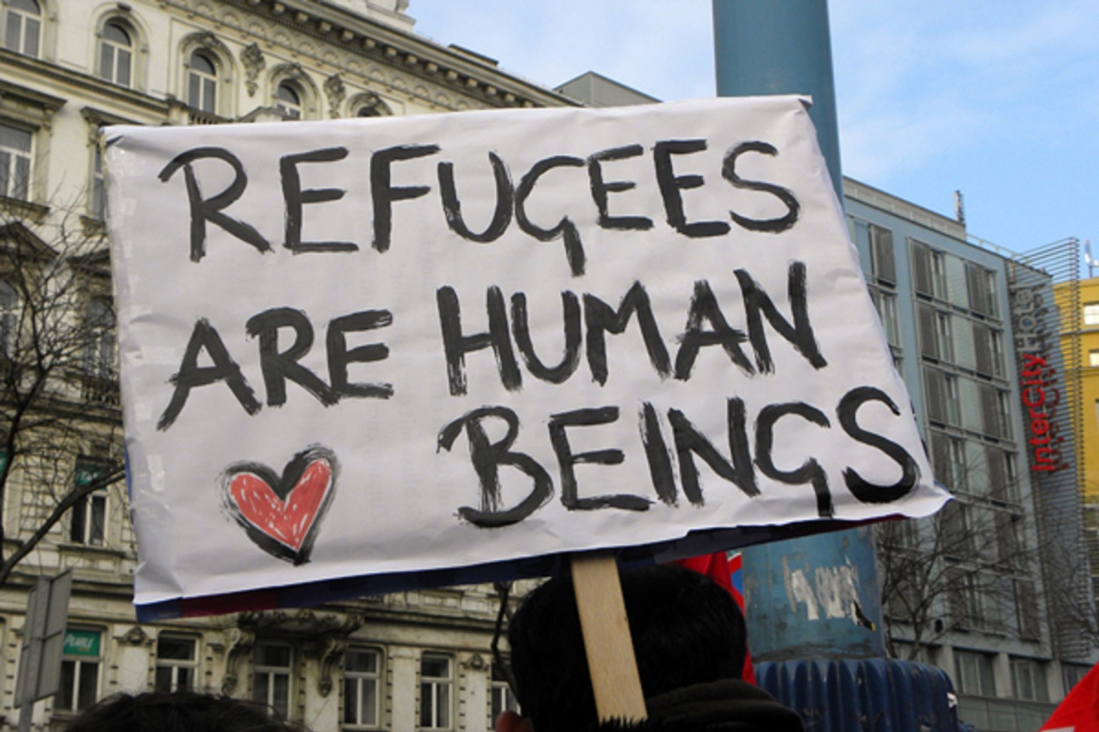 Sign: refugees are human beings