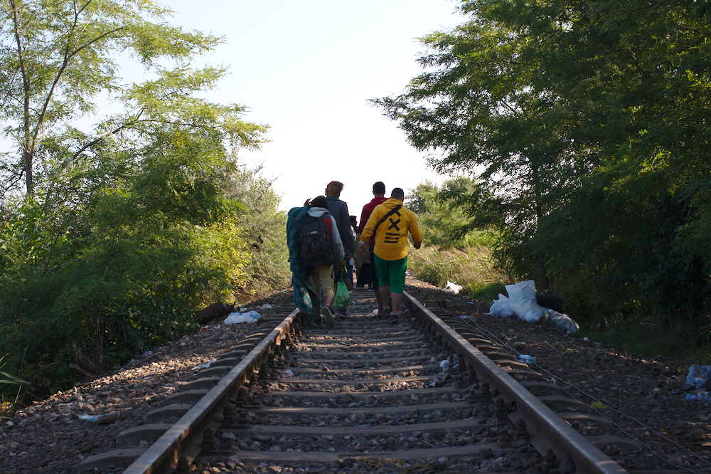 Refugees on railroad tracks