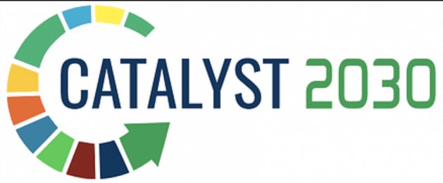 Catalyst 2030 logo. Words: Catalyst in blue. 2030 in Green. Arrow filled with many different colors starting in a circle above the second a in Catalyst, continuing around the C in Catalyst, and ending again below the second A in catalyst. Colors in arrow: green, yellow, blue, green, yellow, orange, blue, green, brown, blue, and green.