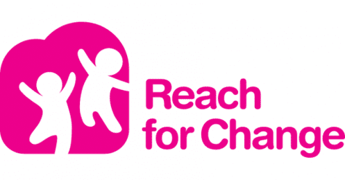 "Picture of two cartoon children outlines (in white) with arms up jumping in a pink background; letters in Pink to the right of the picture saying ""Reach for Change"" in the same color Pink as the background"