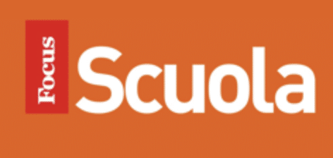 Focus Scuola Logo; Entire Logo a giant orange rectangular block. Inside it and to the left, Focus written vertically in white, inside of a red rectangle. To the right, Scuola written in white against the orange background.