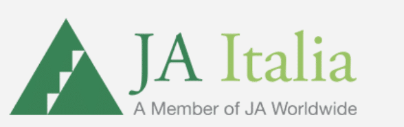 Logo for Junior Achievement Italia; big green triangle with a smaller green triangle inside that has white steps going up one of the sides. JA Italia in words off to the right