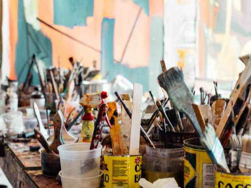 table full of painting brushes